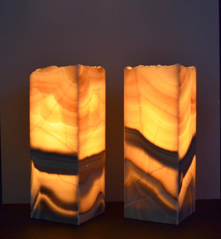 Onyx square base ambient lamps with a rough natural edge.