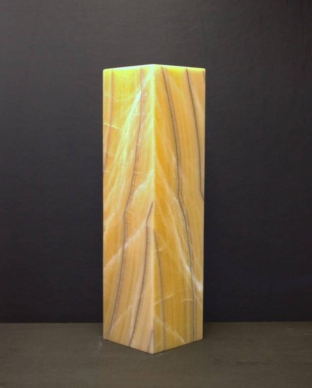 Square based ambient table lamp in onyx.