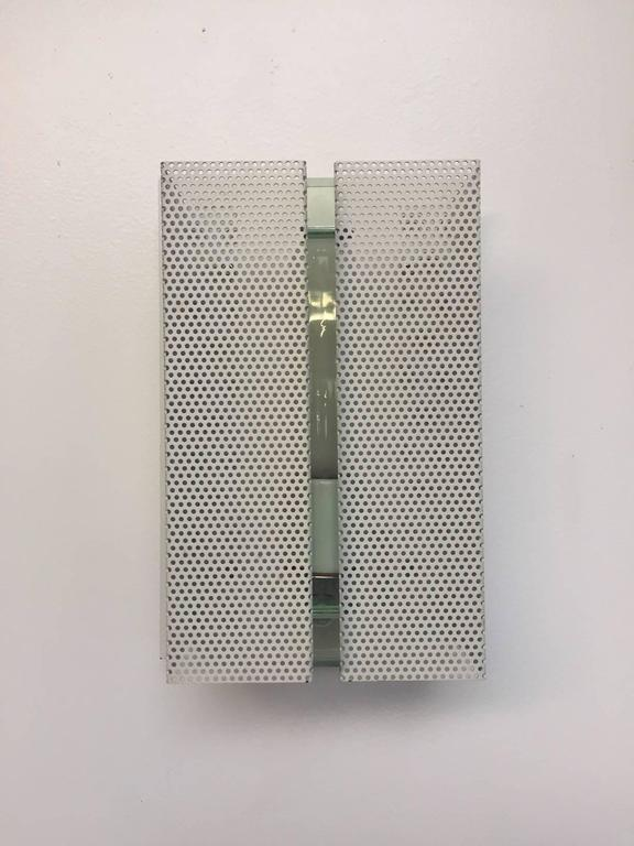 Wall sconce with perforated metal. Four available.