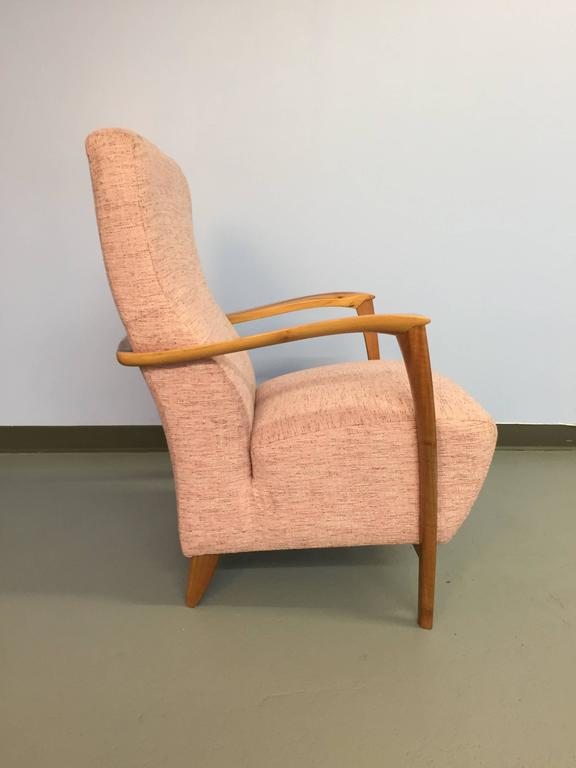 The beauty of this armchair is in the profile and detail: the front legs and arms have a taper and arc pleasing to the eye, and carved rounded details pleasing to the touch. The arms wraparound the back of the chair, completing the line. The pink
