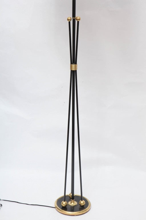 A 1950s American Mid-Century Modern brass and painted metal floor lamp. Shade not included