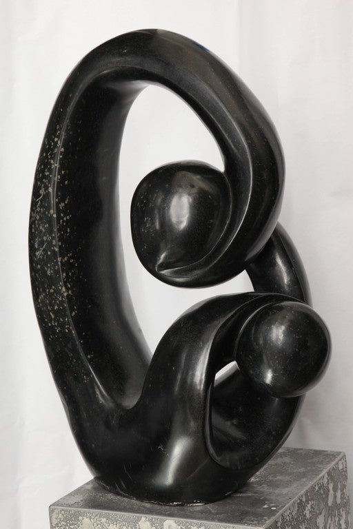 A Shona African modernist sculpture, produced circa 1990s, masterfully hand-carved from marble. Markings include artist's signature [Edmore Makotore] to the bottom of the sculpture.