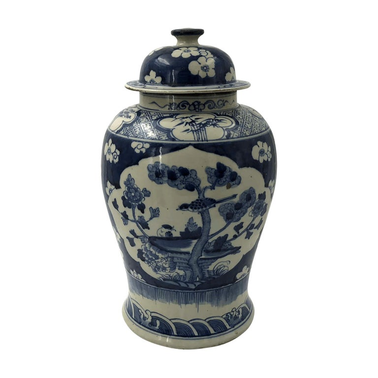 Chinese export blue and white lidded Ginger jars decorated with medallion trees and bird designs.  Dimensions: 10
