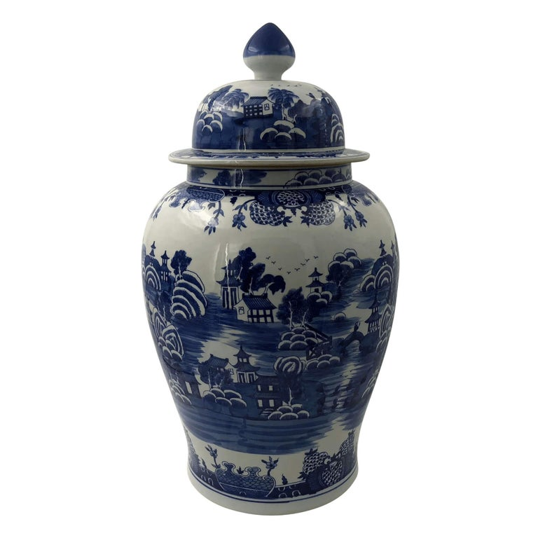 Chinese blue and white hand-painted ceramic lidded Ginger jars with Chinese garden pattern decoration.  Dimensions: 14.5