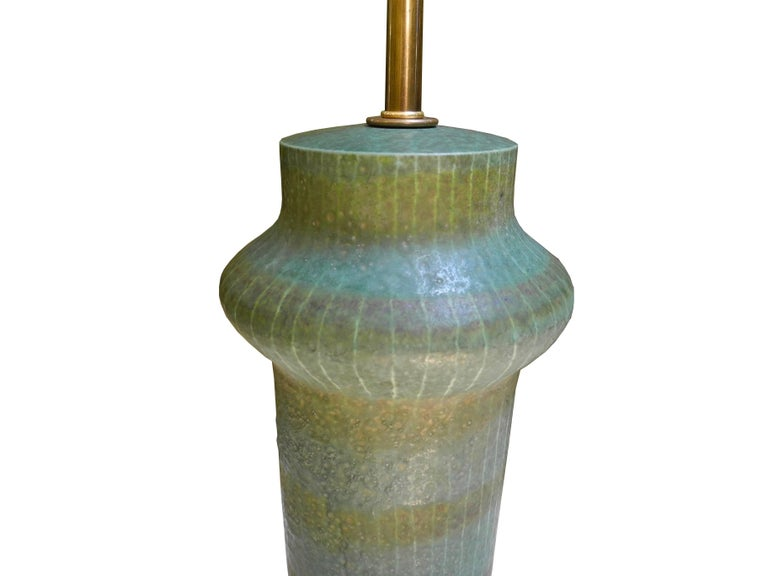 This 1950s ceramic lamp is stamped Made in Italy yet has a beautiful glaze and shape that is reminiscent of Japanese or Danish midcentury pottery. Top of the ceramic measures 14.25 inches.