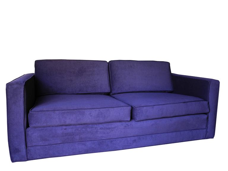 """This ultra modern boxy custom settee designed by Charles Pfister for the home or office is upholstered in a deep aubergine / purple cotton velvet. The arm height is 24"""". Seat height is 16"""". The top of the back cushion is 28"""". 68"""""""