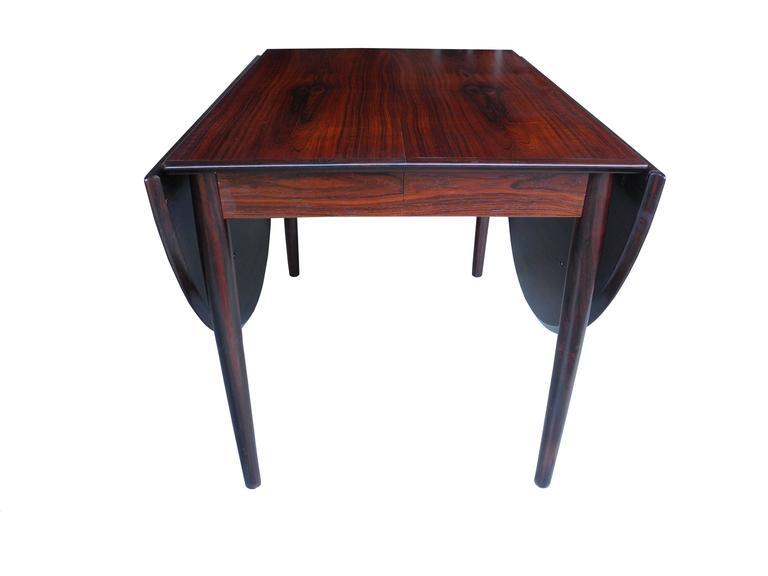 Scandinavian Modern Danish Modern Drop Leaf Solid Rosewood Dining Table by Henry Rosengren Hansen For Sale