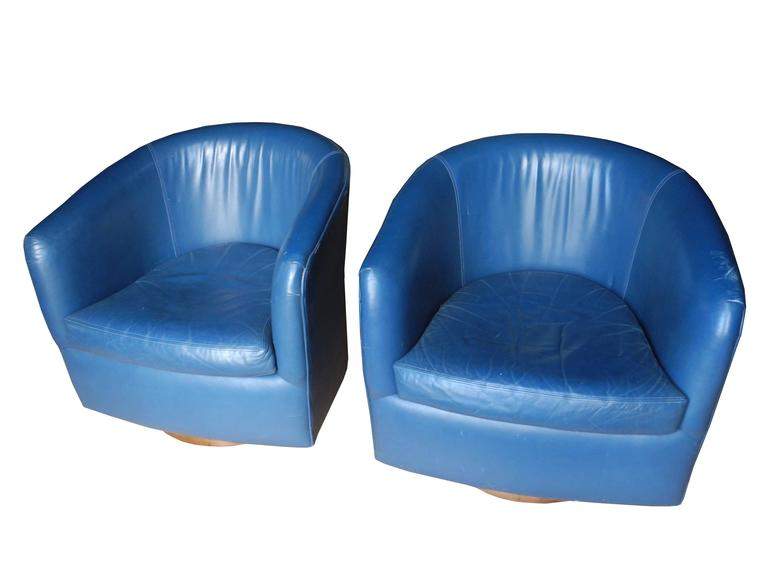 Pair Of Mid Century Modern Blue Leather Swivel Lounge