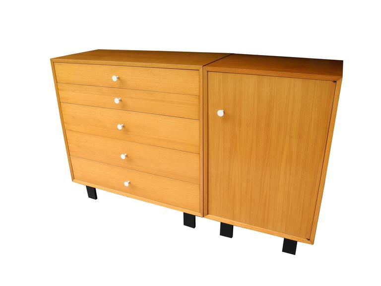 This Five Drawer Dresser Stands Next To A Single Cabinet With Shelf And Hanging