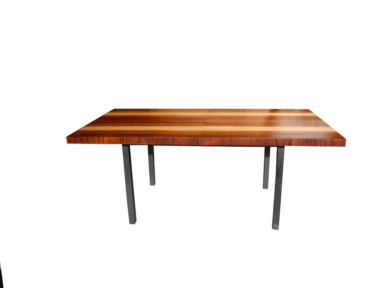 This table is a display of three wood types. Rosewood, walnut and oak. It extends with two additional leaves. All have been refinished to match. It's all about the wood! Dimensions below are without leaves. Each leaf is 39 x 20. You can add an