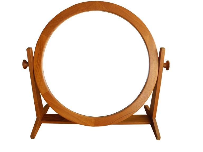 This Danish modern tilting and adjustable mirror was made in Denmark by Pedersen & Hansen in teak.