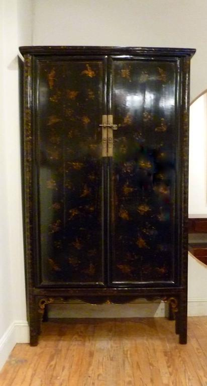 A Large Refined And Elegant Black Lacquer Armoire With Gold Gilt Motif,  Brass Fitting,