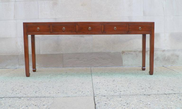 Fine Jumu wood console table with five drawers and brass fitting. Simple and elegant form.  We carry fine quality furniture with elegant finished and has been appeared many times in
