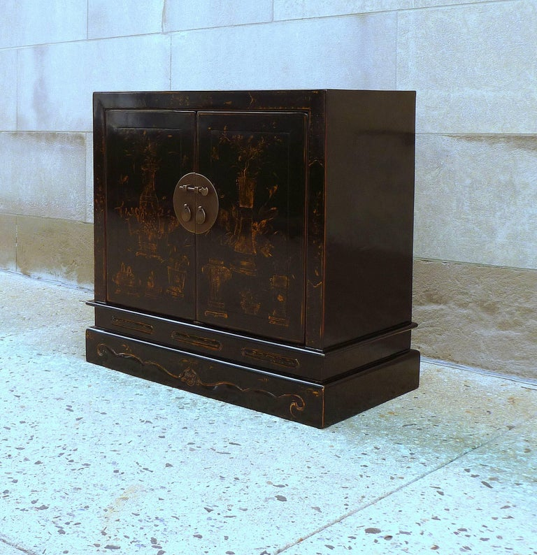 Polished Fine Black Lacquer Chest with Gilt Motif For Sale