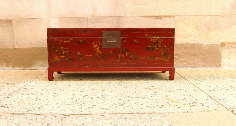 Fine red lacquer trunk with gilt landscape motif, beautiful color finished and form, trunk on stand.  We carry fine quality furniture with elegant finished and has been appeared many times in