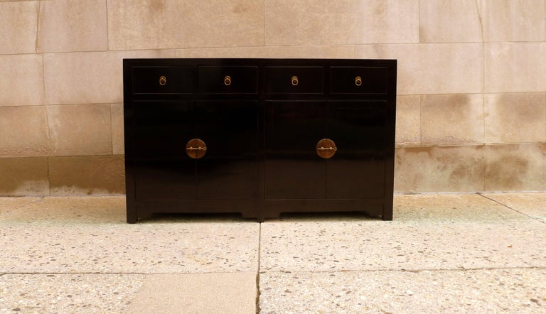 Fine black lacquer sideboard with drawers and open doors. Very elegant, simple form and beautiful color.  We carry fine quality furniture with elegant finished and has been appeared many times in