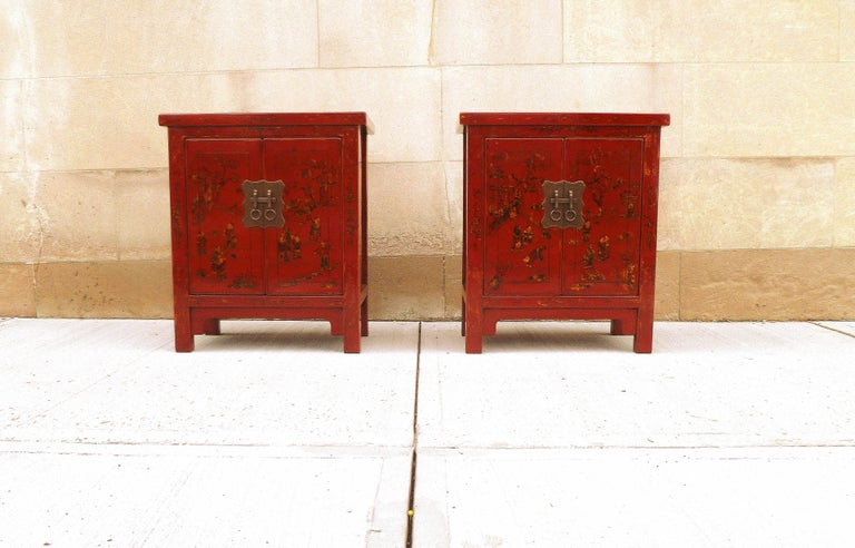 A pair of fine red lacquer chests with hand-painted gold gilt motif, beautiful color, form and lines.