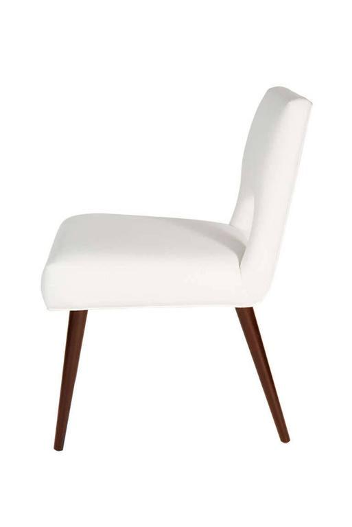 """Solid walnut turned dowel leg dining chairs with open upholstered back and fully upholstered tight seat.  Seat height 18.5""""  COM requirements: 1.5 yards  5% up-charge for contrasting fabrics and or welting COL Requirements:30 sq. feet  5%"""