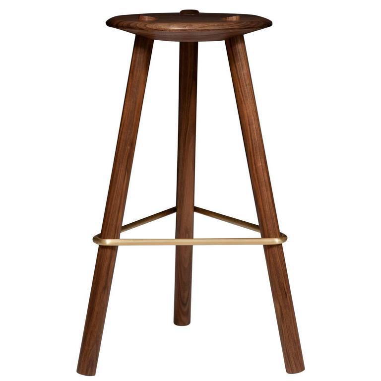 Solid select walnut tripod stool: (counter height or bar height) with satin brass stretcher. 