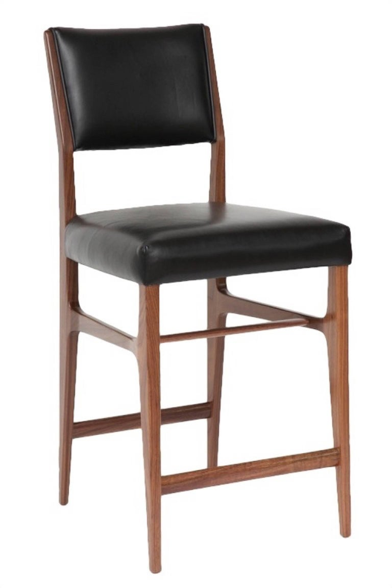 """Maze walnut counter stool. Measures: Seat height-25"""" Custom orders have a lead time of 8-10 weeks FOB NYC. Lead time contingent upon selection of finishes, approval of shop drawings (if applicable), and receipt of 1.5 yards COM / 30 sq. feet COL"""