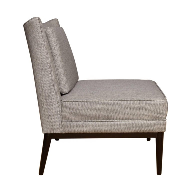 Colin slipper chair. Single loose back cushion with generous seat width and depth.