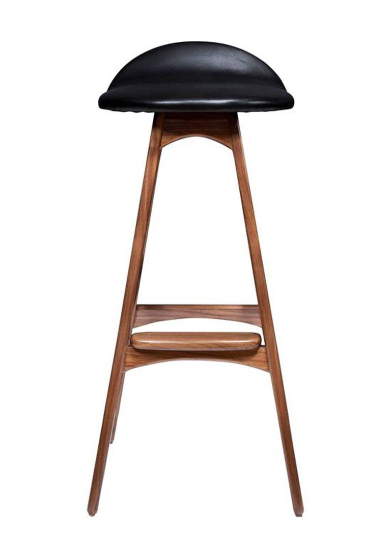 """Boyd counter stool shown in solid walnut with black leather seat. Seat height -29.75"""" Custom orders have a lead time of 10-12 weeks FOB NYC. Lead time contingent upon selection of finishes, approval of shop drawings (if applicable), and receipt"""