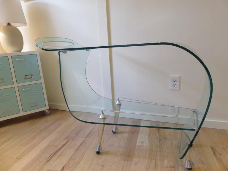 From the ghost collection a Fiam Italia glass bar cart/trolley sleek modern and fabulous in design,hand and industrial made.Brushed steel feet on casters. Immaculate condition.