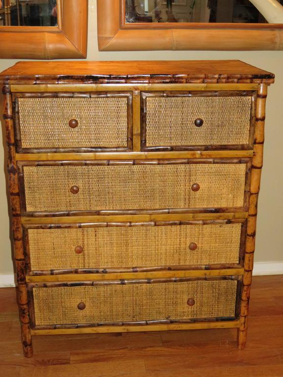 A Bermudantall bamboo and cane five drawer dresser. All drawers pull out on metal rails for easy use. Handcrafted in Bermuda in the British Colonial style. Two small top drawers and three larger drawers, great storage.