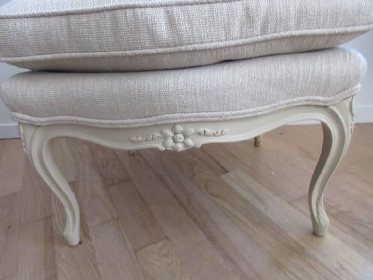 William Sloane of NY known for quality furniture closed their doors in 1985, this is one of a group of Sloane items acquired from a fifth Ave home Fully restored, new upholstery in a Kravet ivory bone linen. Down and cotton cushion, painted frame (a