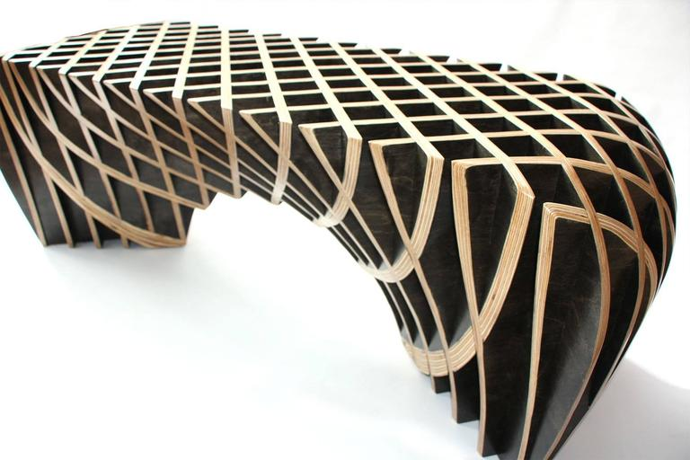 A Bench ,from .The Quarry Collection.  Ryan Dart is no ordinary designer and to quote him in his own words,  We have found that inspiration comes however and whenever it wants. Our job at Bones Studio is to quickly capture it before it goes away. We