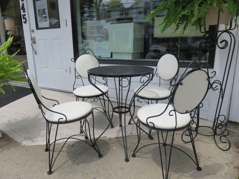 A Mid-Century Woodard bistro set.