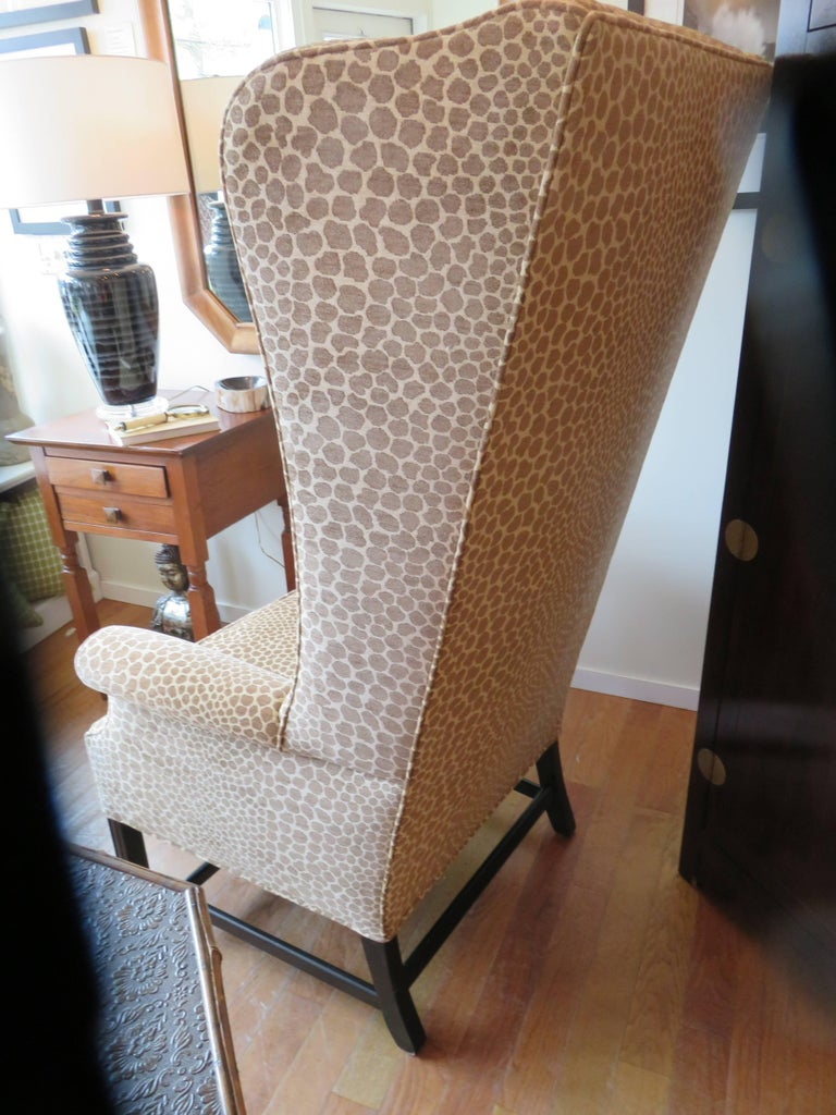 This chair is one of a kind, custom made in England, circa 1925, extremely comfortable and luxurious. The chair has been completely upholstered to the frame. Chenille velvet animal print from Robert Allan. Ebony wood frame, click on to  see the foot