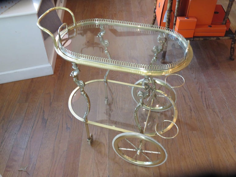 A rare find in this beautiful solid brass highly detailed Maison Baguès bar cart. The tray removes on the top, the piece is ornate and fine, even the little square screws are all handmade. Piping female figures adorn all four legs, the