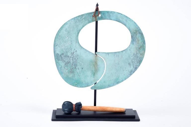 This gong has an amazingly distinctive form and an incredible patina. It is a smaller scale than the Classic solid bronze gongs he created. It comes with a Stand and mallet of appropriate scale.