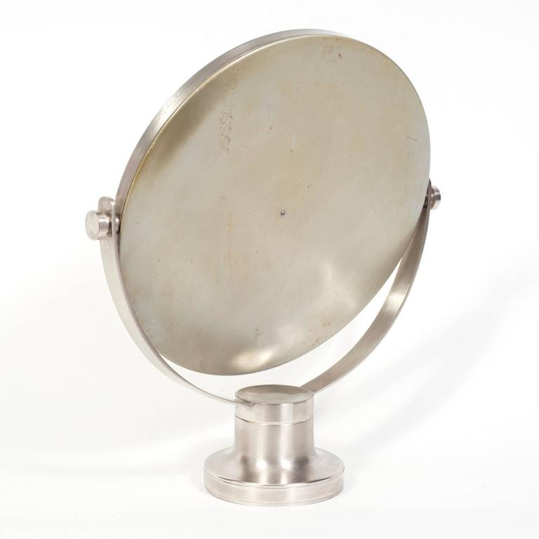 Mazza, known for his mirrors, designed a variety of these finely made vanity mirrors.