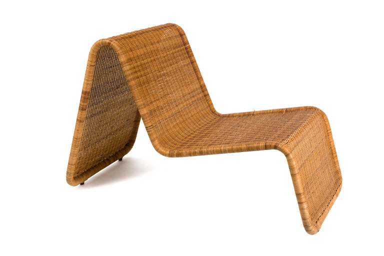 These chairs have a brilliantly simple design that is both beautifully sculptural and functional. They can be used indoors or outdoors having lacquered tubular steel frames and the natural woven wicker.