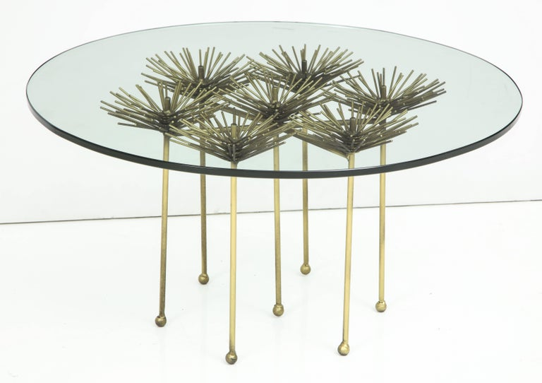 Based on a midcentury design this table was most likely originally produced by Silas Seandel or Curtis Jere.