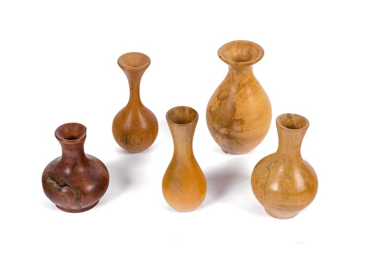 Melvin Lindquist began turning in the 1930s as a vertical turret lathe operator for the General Electric Company. In his shop at home, he began an exploration of the vase form through woodturning which has continued for over 50 years. He was one of