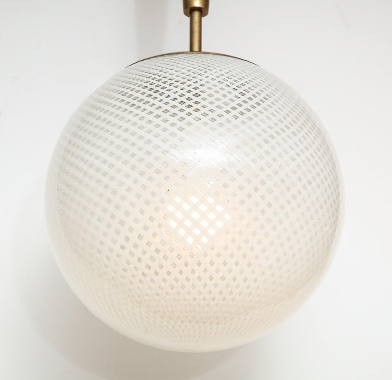 Italian Mid-Century Style Patterned Murano Globe Pendant with Tapered Brass Stem In Excellent Condition For Sale In New York, NY