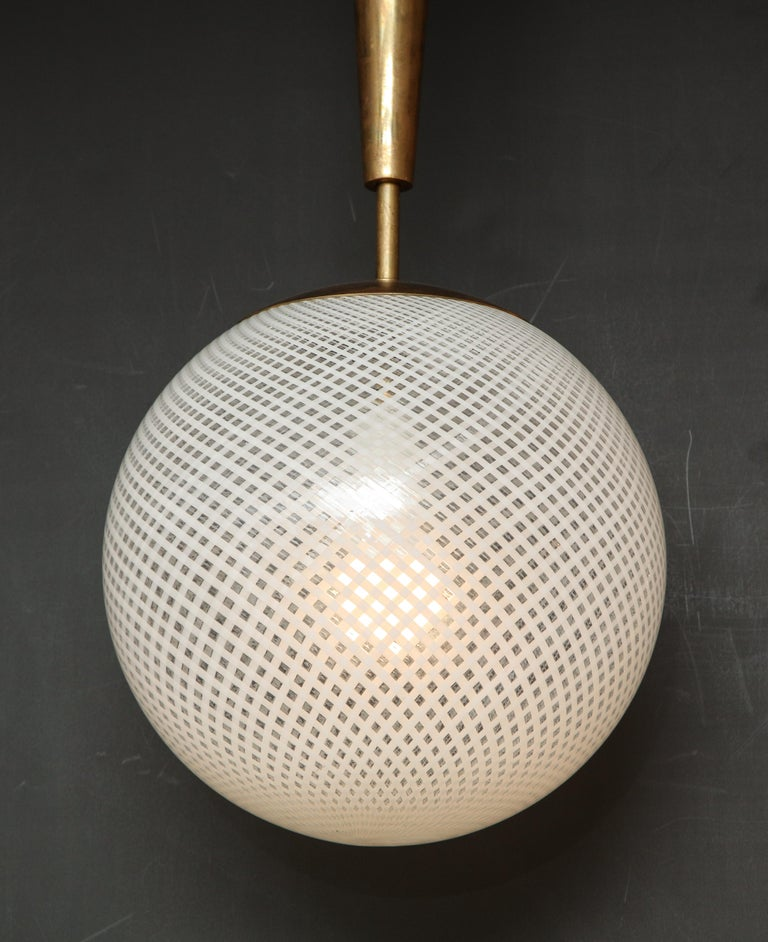 Contemporary Italian Mid-Century Style Patterned Murano Globe Pendant with Tapered Brass Stem For Sale