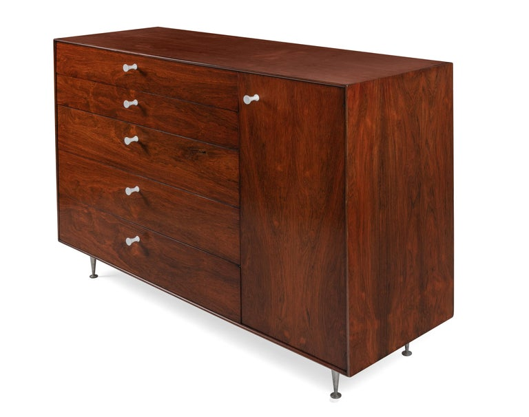 An outstanding piece of the highly desirable Thin edge line of furniture. The quality of the rosewood is magnificent and the storage possibilities are excellent.