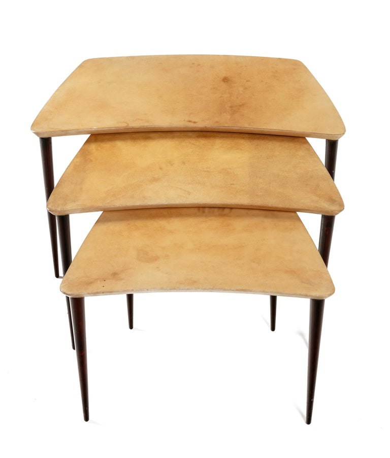 A lovely form for nesting tables. The measurements indicated are for the largest of the three.