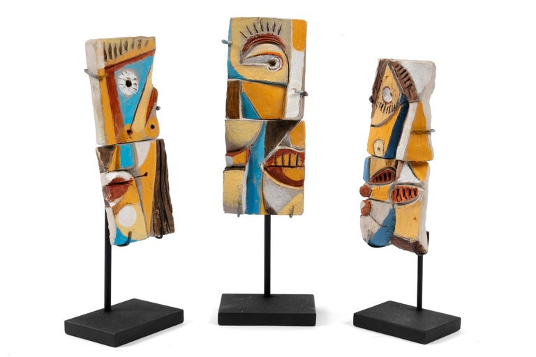 Although he is primarily known for his tile tables he went on to create amazing sculptures later in his life. This is a playful example of that later work. The measurements indicated are for one two piece sculpture without the stand.