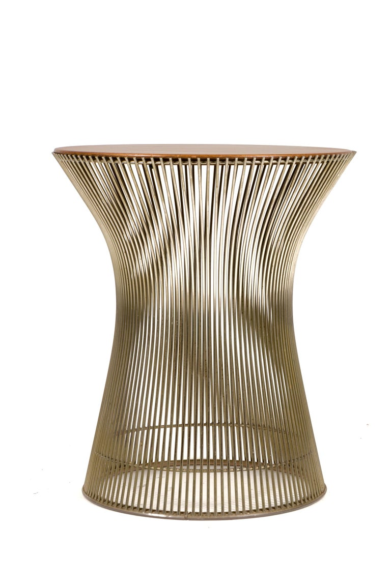 Part of the Platner collection by Knoll in 1962 the side table well demonstrates Platner's Industrial materials married with the graceful organic design. The table is constructed in walnut top and chrome base.