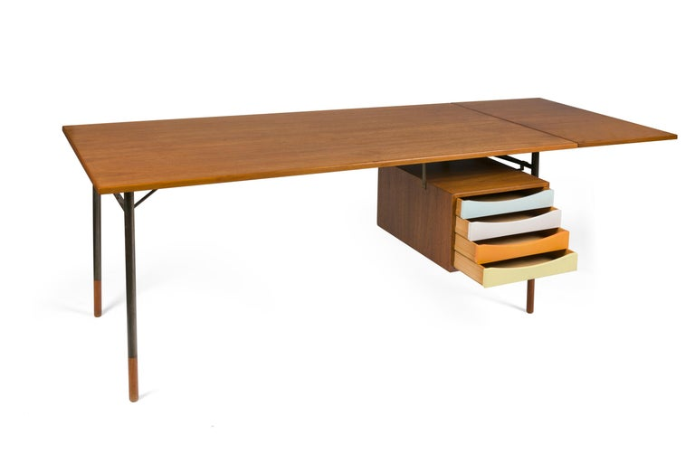 A spectacular example of Finn Juhl's iconic designs. This model includes his signature drawer unit and a removable extension. The drawer unit also removes allowing the desk to be used as a table.