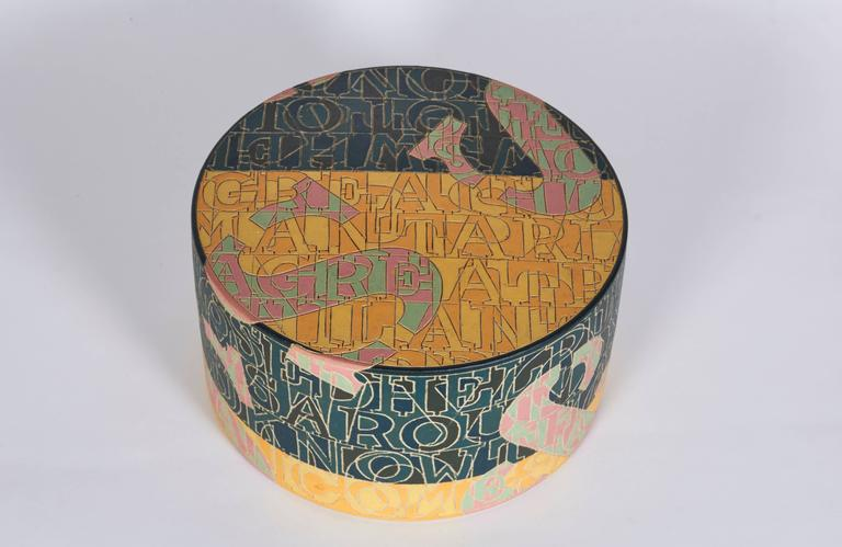 Letters and characters are the continuous decoration on Kristiansen's stoneware works, dishes, bowls and vases in bright colors. Scripture is incised or in relief and is in the early works fragments of poems and songs.