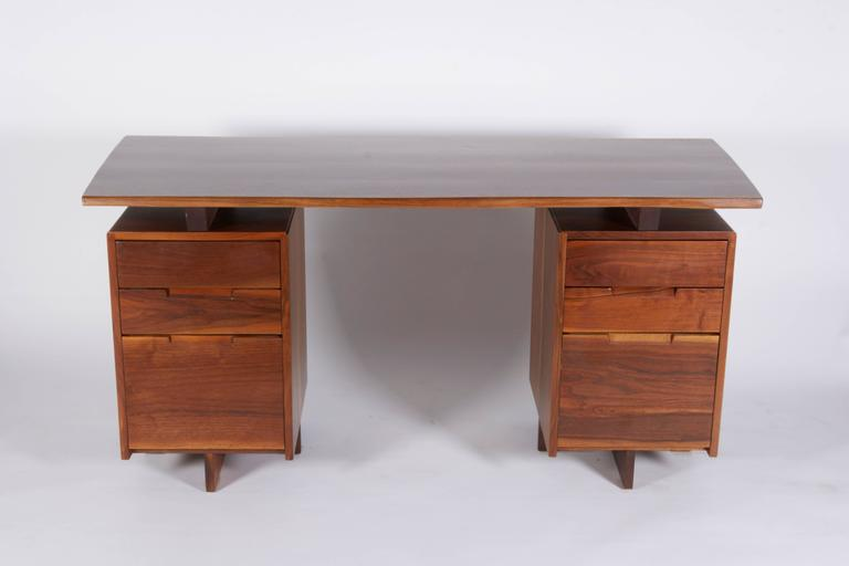 A Classic Nakashima desk both beautiful and functional with ample storage.