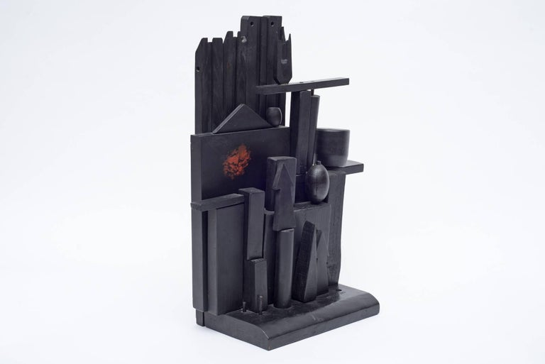 Louise Nevelson's wood sculptures reflect the influence of many movements including Abstract Expressionism, Cubism and Surrealism. Monochromatic and usually black, Nevelson assembled the sculptures using discarded pieces of wood.