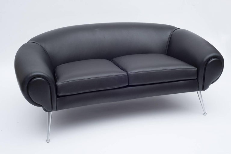 An incredibly rare example of Illum Wikkelsø's work. The form is consistent with his other plush and luxurious leather furniture accented by the untypical sleek aluminum legs. There is also a lounge chair available in the same form.
