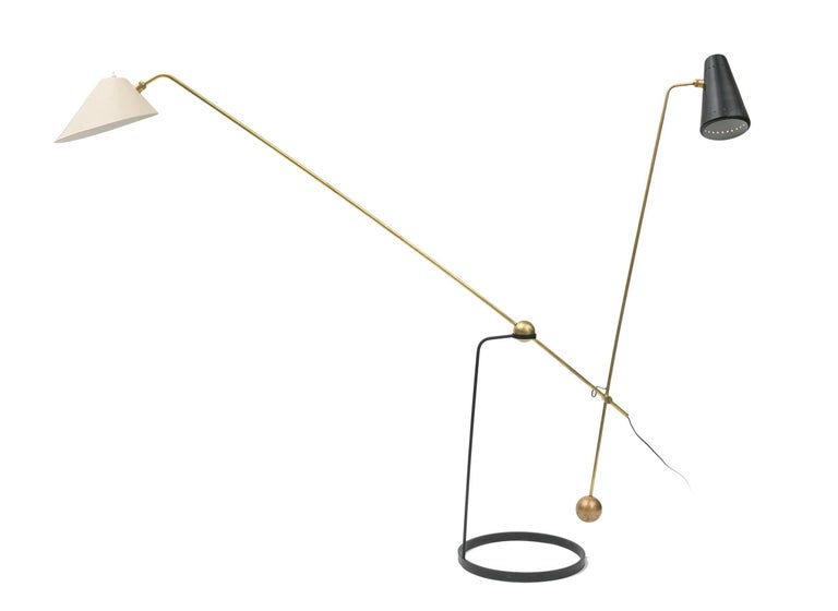 A rare double branch floor lamp designed by Pierre Guariche and manufactured by Pierre Disderrot.
